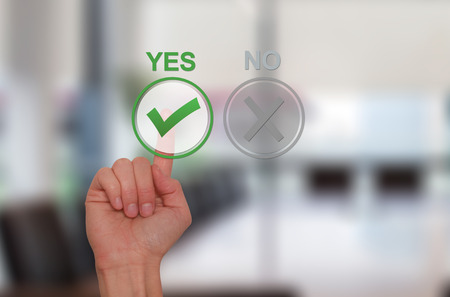 tests: Hand Choose yes on virtual screen. Business technology concept. Isolated on office. Stock Image.