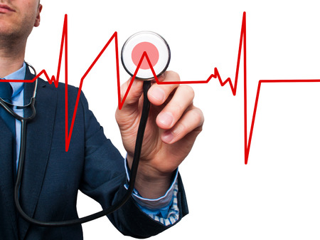 preventive medicine: Closeup portrait handsome business man, male corporate employee, worker listening to  heart beat with stethoscope isolated on white background. Preventive medicine, financial condition concept