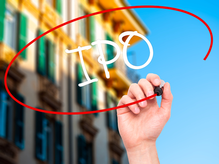 insider: Man Hand writing IPO (Initial Public Offering)   with black marker on visual screen. Isolated on background. Business, technology, internet concept. Stock Photo