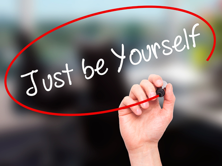 true self: Man Hand writing Just be Yourself with black marker on visual screen. Isolated on background. Business, technology, internet concept. Stock Photo Stock Photo