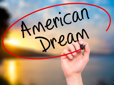ethos: Man Hand writing American Dream with black marker on visual screen. Isolated on nature. Business, technology, internet concept. Stock Image