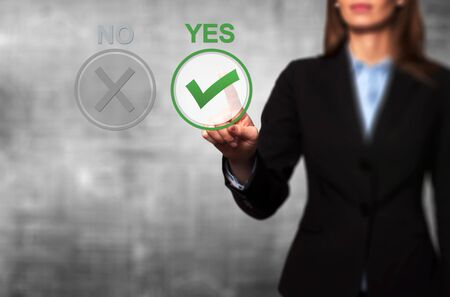 yes button: Hand of businesswoman press Yes button. Decision making, business technology concept.. Isolated on grey. Stock Image. Stock Photo