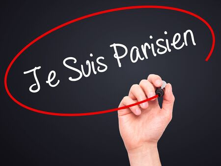 killed: Man Hand writing Je Suis Parisien with black marker on visual screen. Isolated on black. Stock Photo