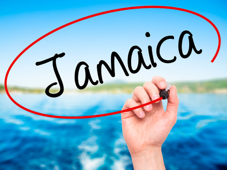 bob: Man Hand writing Jamaica  with black marker on visual screen. Isolated on nature. Business, technology, internet concept. Stock Photo Stock Photo