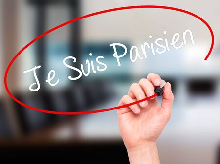 visual screen: Man Hand writing Je Suis Parisien with black marker on visual screen. Isolated on office. Stock Photo