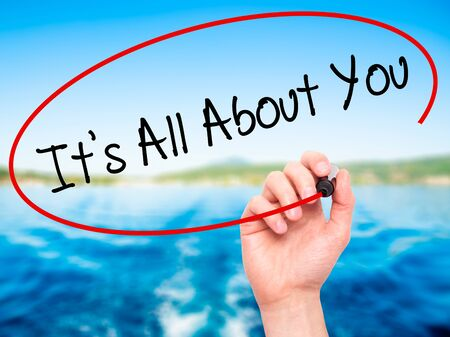 about you: Man Hand writing Its All About You with black marker on visual screen. Isolated on background. Business, technology, internet concept. Stock Photo Stock Photo