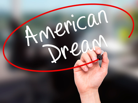 ethos: Man Hand writing American Dream with black marker on visual screen. Isolated on office. Business, technology, internet concept. Stock Image Stock Photo