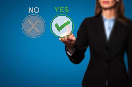 yes button: Hand of businesswoman press Yes button. Decision making, business technology concept.. Isolated on blue. Stock Image.
