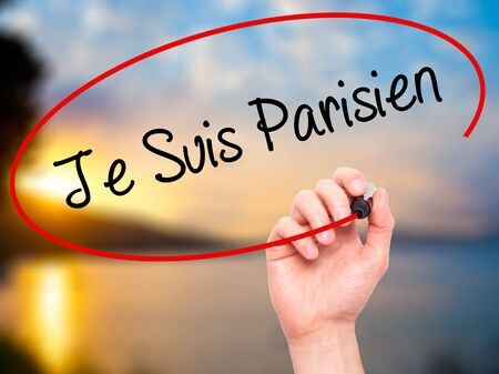writing on screen: Man Hand writing Je Suis Parisien with black marker on visual screen. Isolated on nature. Stock Photo