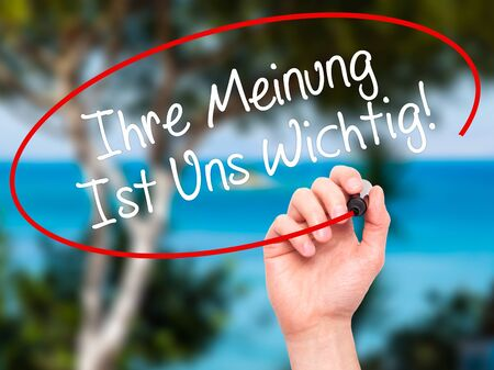 solicitation: Man Hand writing Ihre Meinung Ist Uns Wichtig! (Your Opinion is Important to Us in German) with marker on visual screen. Isolated on background. Business, technology, internet concept. Stock Photo