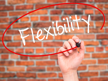 easygoing: Man Hand writing Flexibility with black marker on visual screen. Isolated on background. Business, technology, internet concept. Stock Photo Stock Photo