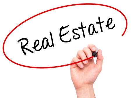finer: Man Hand writing Real Estate  with black marker on visual screen. Isolated on white. Business, technology, internet concept. Stock Photo