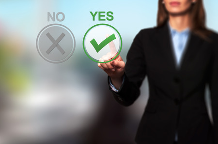 assent: Hand of businesswoman press Yes button. Decision making, business technology concept.. Isolated on office. Stock Image.