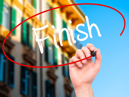 end of the trail: Man Hand writing  Finish with black marker on visual screen. Isolated on background. Business, technology, internet concept. Stock Photo Stock Photo