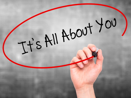 about you: Man Hand writing Its All About You with black marker on visual screen. Isolated on grey. Business, technology, internet concept. Stock Photo