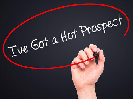 prospecting: Man Hand writing Ive Got a Hot Prospect with black marker on visual screen. Isolated on black. Business, technology, internet concept. Stock Photo Stock Photo