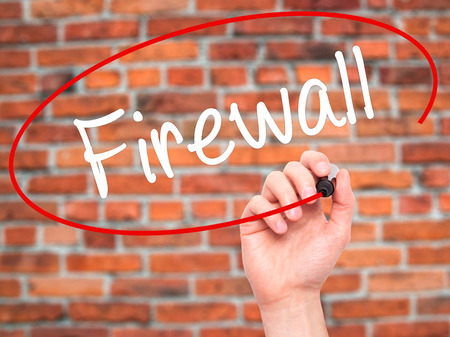 Man Hand writing Firewall  with black marker on visual screen. Isolated on background. Business, technology, internet concept. Stock Photo