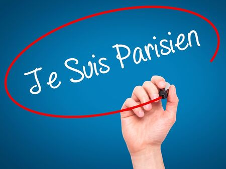 visual screen: Man Hand writing Je Suis Parisien with black marker on visual screen. Isolated on blue. Stock Photo