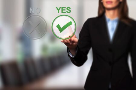yes button: Hand of businesswoman press Yes button. Decision making, business technology concept.. Isolated on office. Stock Image.