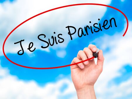 writing on screen: Man Hand writing Je Suis Parisien with black marker on visual screen. Isolated on sky. Stock Photo Stock Photo