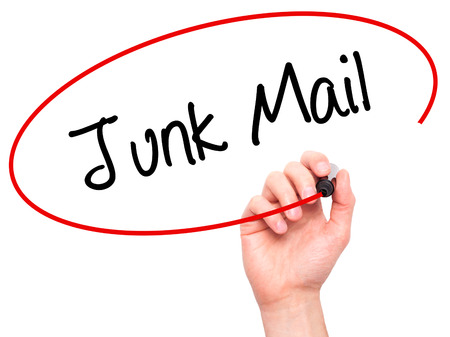 solicitors: Man Hand writing Junk Mail with black marker on visual screen. Isolated on white. Business, technology, internet concept. Stock Photo Stock Photo