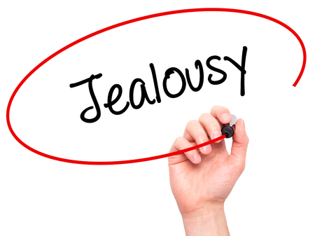 jealousy: Man Hand writing Jealousy with black marker on visual screen. Isolated on white. Business, technology, internet concept. Stock Photo Foto de archivo