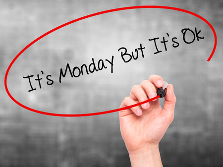 acceptable: Man Hand writing Its Monday But Its Ok with black marker on visual screen. Isolated on grey. Business, technology, internet concept. Stock Photo