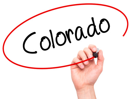 denver parks: Man Hand writing Colorado  with black marker on visual screen. Isolated on white. Business, technology, internet concept.