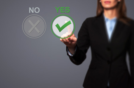 assent: Hand of businesswoman press Yes button. Decision making, business technology concept.. Isolated on grey. Stock Image. Stock Photo