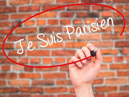 writing on screen: Man Hand writing Je Suis Parisien with black marker on visual screen. Isolated on bricks. Stock Photo Stock Photo