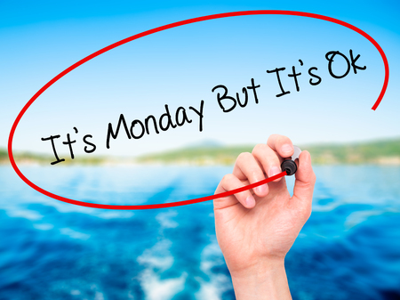 acceptable: Man Hand writing Its Monday But Its Ok with black marker on visual screen. Isolated on nature. Business, technology, internet concept. Stock Photo Stock Photo
