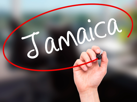 bob: Man Hand writing Jamaica  with black marker on visual screen. Isolated on office. Business, technology, internet concept. Stock Photo