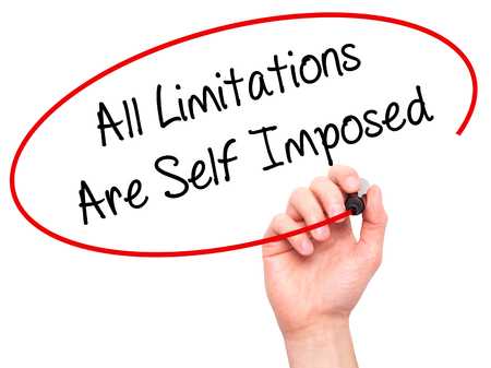 imposed: Man Hand writing All Limitations Are Self Imposed with black marker on visual screen. Isolated on background. Business, technology, internet concept. Stock Photo