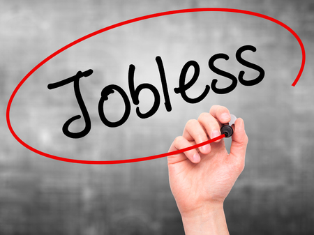 jobless: Man Hand writing  Jobless  with black marker on visual screen. Isolated on background. Business, technology, internet concept. Stock Photo