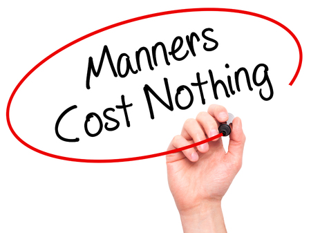 credible: Man Hand writing Manners Cost Nothing with black marker on visual screen. Isolated on white. Business, technology, internet concept. Stock Photo