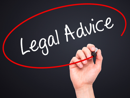 governing: Man Hand writing Legal Advice with black marker on visual screen. Isolated on black. Business, technology, internet concept. Stock Photo