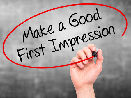 genuine good: Man Hand writing Make a Good First Impression with black marker on visual screen. Isolated on background. Business, technology, internet concept. Stock Photo Stock Photo
