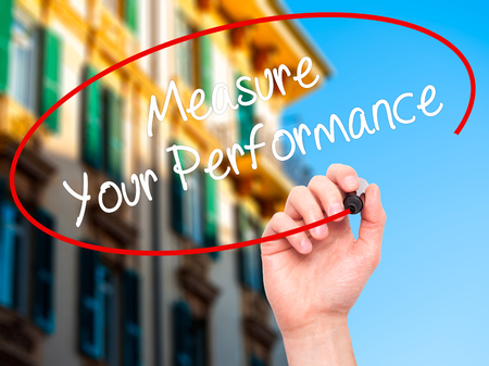 satisfactory: Man Hand writing Measure Your Performance with black marker on visual screen. Isolated on city. Business, technology, internet concept. Stock Photo Stock Photo