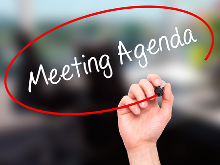 meeting agenda: Man Hand writing Meeting Agenda  with black marker on visual screen. Isolated on office. Business, technology, internet concept. Stock Photo Stock Photo