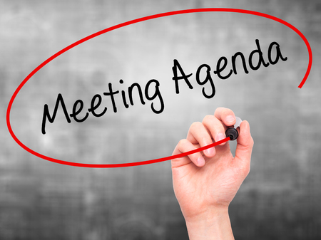 meeting agenda: Man Hand writing Meeting Agenda  with black marker on visual screen. Isolated on grey. Business, technology, internet concept. Stock Photo Stock Photo