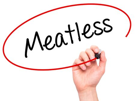 meatless: Man Hand writing Meatless  with black marker on visual screen. Isolated on white. Business, technology, internet concept. Stock Photo