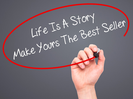 narrator: Man Hand writing Life Is A Story Make Yours The Best Seller with black marker on visual screen. Isolated on background. Business, technology, internet concept. Stock Photo
