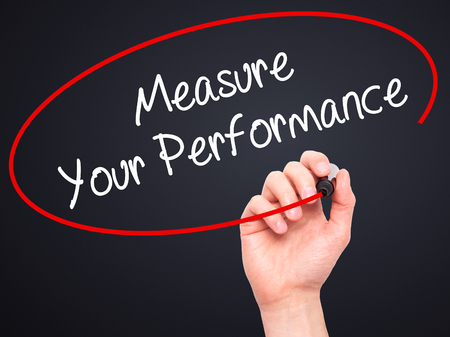 satisfactory: Man Hand writing Measure Your Performance with black marker on visual screen. Isolated on black. Business, technology, internet concept. Stock Photo