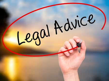governing: Man Hand writing Legal Advice with black marker on visual screen. Isolated on nature. Business, technology, internet concept. Stock Photo