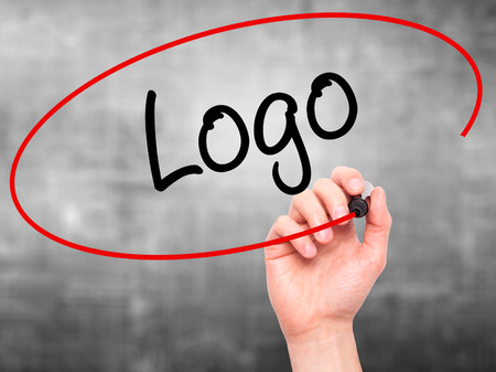 branded: Man Hand writing Logo  with black marker on visual screen. Isolated on background. Business, technology, internet concept. Stock Photo
