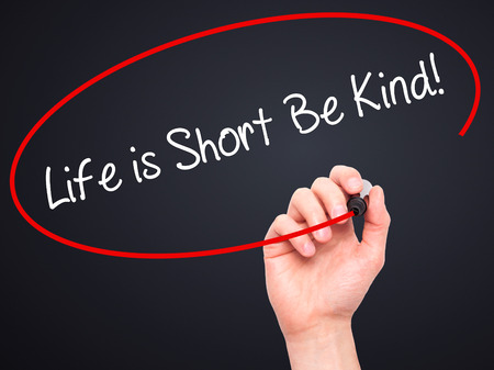 helpfulness: Man Hand writing Life is Short Be Kind! with black marker on visual screen. Isolated on black. Business, technology, internet concept. Stock Photo Stock Photo