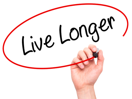 longer: Man Hand writing Live Longer with black marker on visual screen. Isolated on white. Business, technology, internet concept. Stock Photo