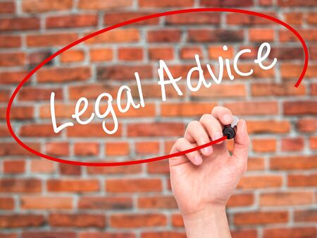 governing: Man Hand writing Legal Advice with black marker on visual screen. Isolated on bricks. Business, technology, internet concept. Stock Photo
