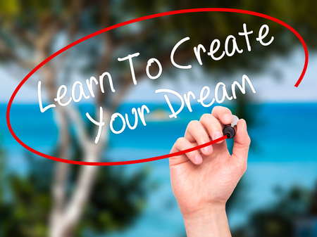 dreamscape: Man Hand writing Learn To Create Your Dream with black marker on visual screen. Isolated on background. Business, technology, internet concept. Stock Photo