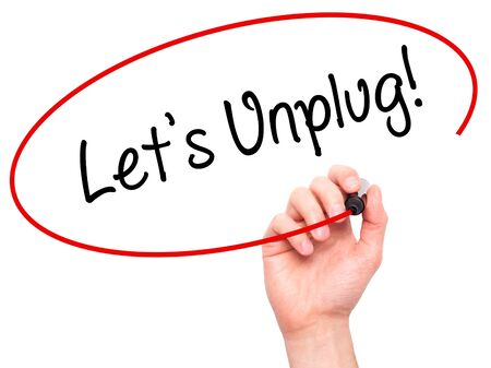 unplug: Man Hand writing Lets Unplug! with black marker on visual screen. Isolated on white. Business, technology, internet concept. Stock Photo